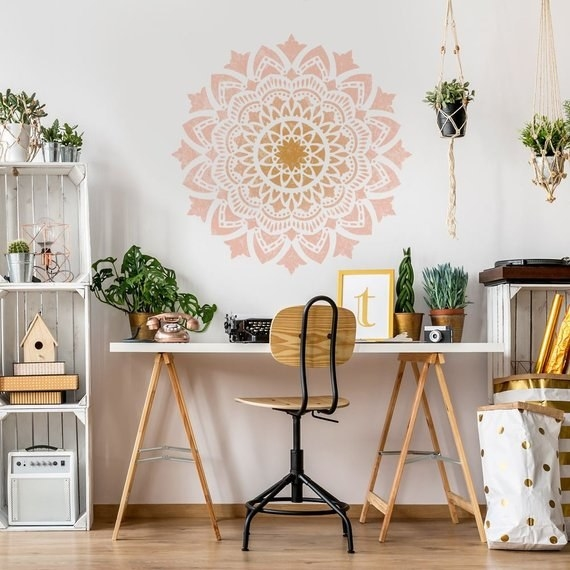 A big design painted over a desk using the stencil from Cutting Edge Stencils