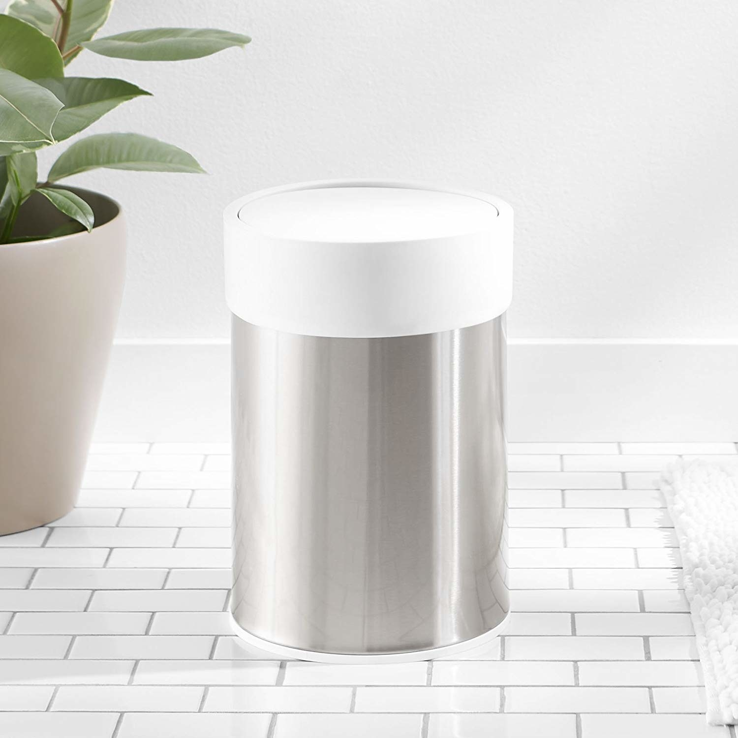 Amazon Basics stainless steel trashcan with a white lid