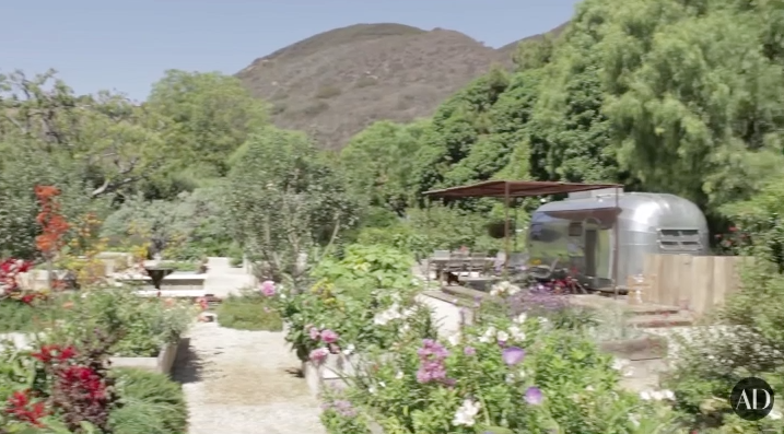 And look at this backyard!!!!!!!! I don't know whether to focus on the botanical garden he's running back there or the airstream/patio hybrid that I would like to live in.