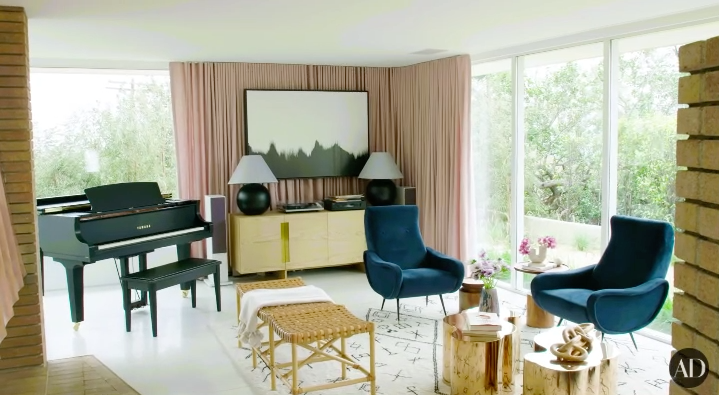 Her husband is a musician, so they have a piano in their sitting room bathed in natural light.