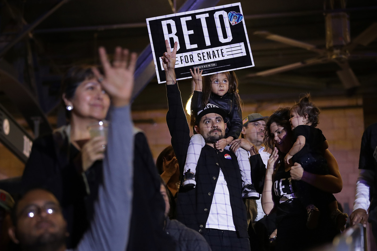 """Michael Diaz de Leon and his daughter, Olivia, 5, attend an election night """"thank you"""" party for O'Rourke at Southwest University Park, Nov. 6, 2018, in El Paso, Texas."""