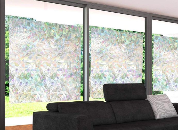 A rainbow refracting window film installed on three large windows