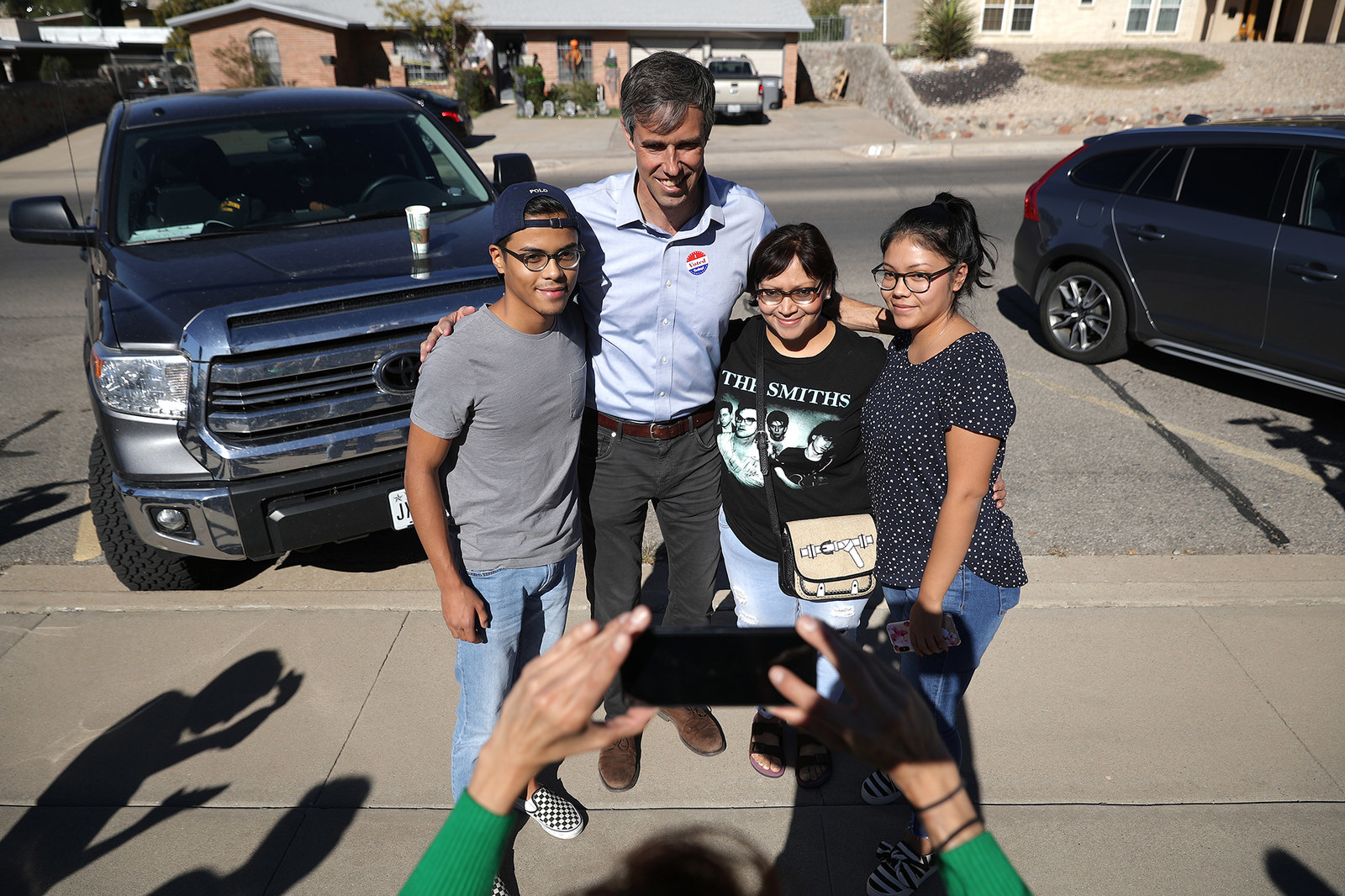 O'Rourke takes a photograph with first-time voter Josiah Martinez (left), his mother Jessica Bouffier, and sister Jordyn Martinez outside the polling place at the Grover and Carolyn Stewart Family Life Center, Nov. 6, 2018, in El Paso, Texas.