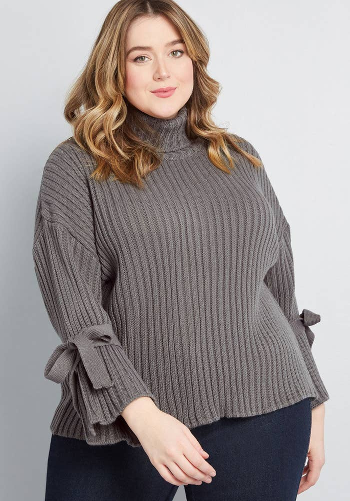 b864cc7690889 A bell-sleeve sweater that ll make you the belle of the ball (or wherever  you wear this