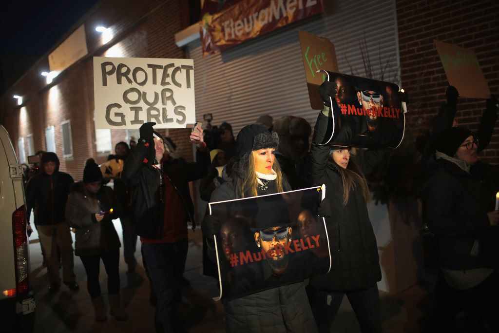 Demonstrators gather near the Chicago studio of singer R. Kelly on Jan. 9 to call for a boycott of his music amid allegations of sexual abuse against young girls.