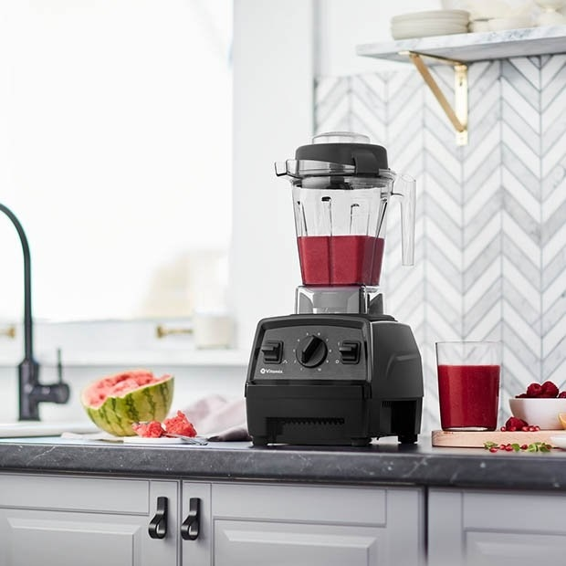 vitamix on counter making a smoothie