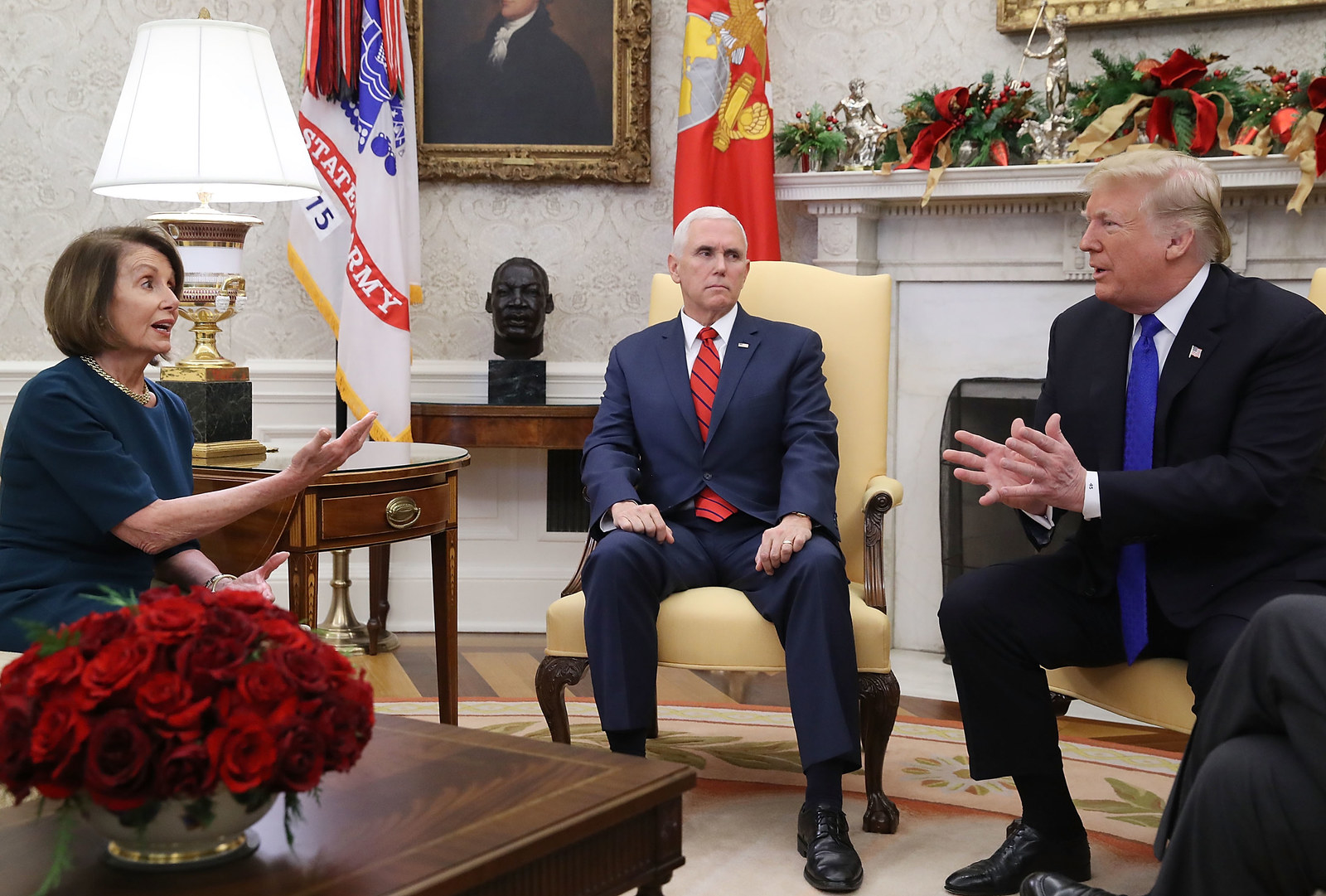 Trump argues about border security with Pelosi as Vice President Mike Pence sits nearby, just over a week before the shutdown began.