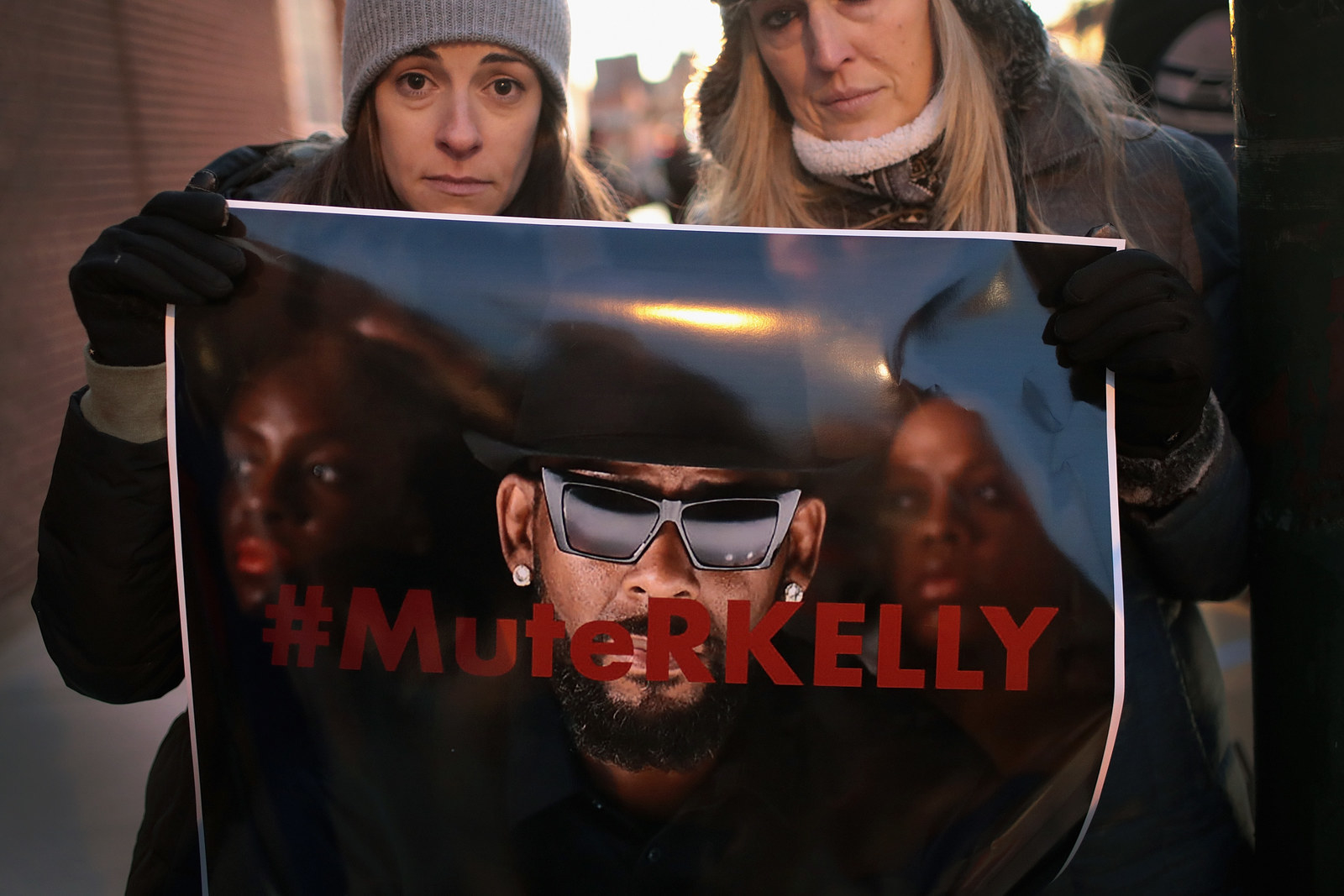 Protesters at Kelly's Chicago studio on Wednesday.