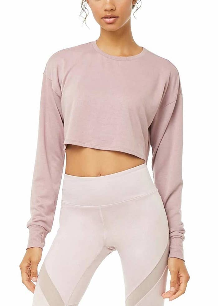 603a0b9be5232 A cropped workout top with trendy thumbholes that ll keep you toasty on the  way to the gym while still looking the part. I m no athlete