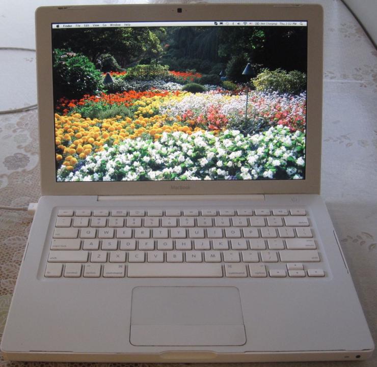 Open Macbook with flower field desktop wallpaper