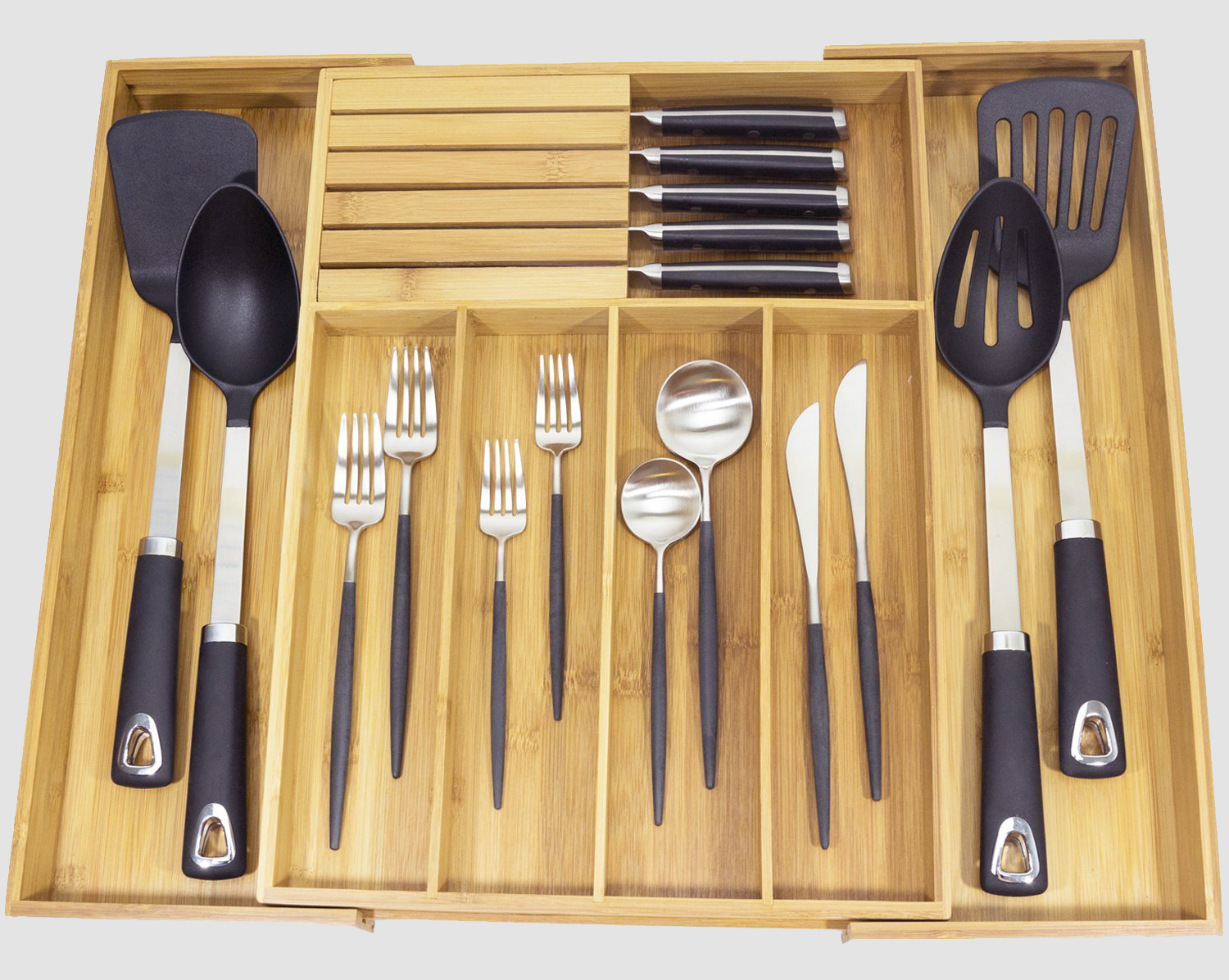 """Promising review: """"This is a really sturdy, nice organizer. I liked that I could take my knives out of my knife block on my counter and put them in it. I threw my knife block away and now have one less thing on my kitchen counter. This adjusts very easily and fits a lot of silverware. Good quality and a good buy."""" —LS Get it from Amazon for $28.99."""