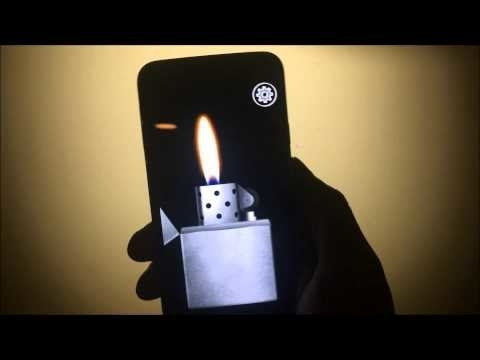 Screenshot of a hand holding an iPhone with a Zippo looking lighter lit on the screen