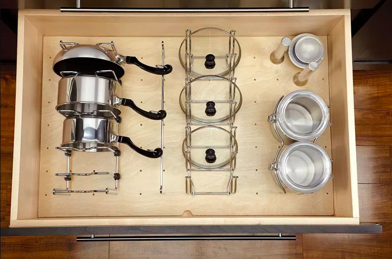 Drawer using peg system to hold pots, lids, and jars in organized system