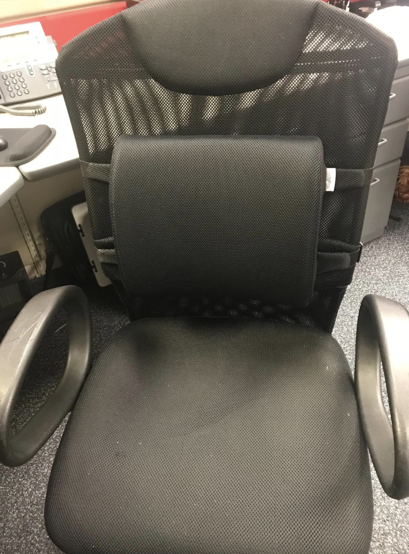 reviewer pic of the black cushion attached around an office chair