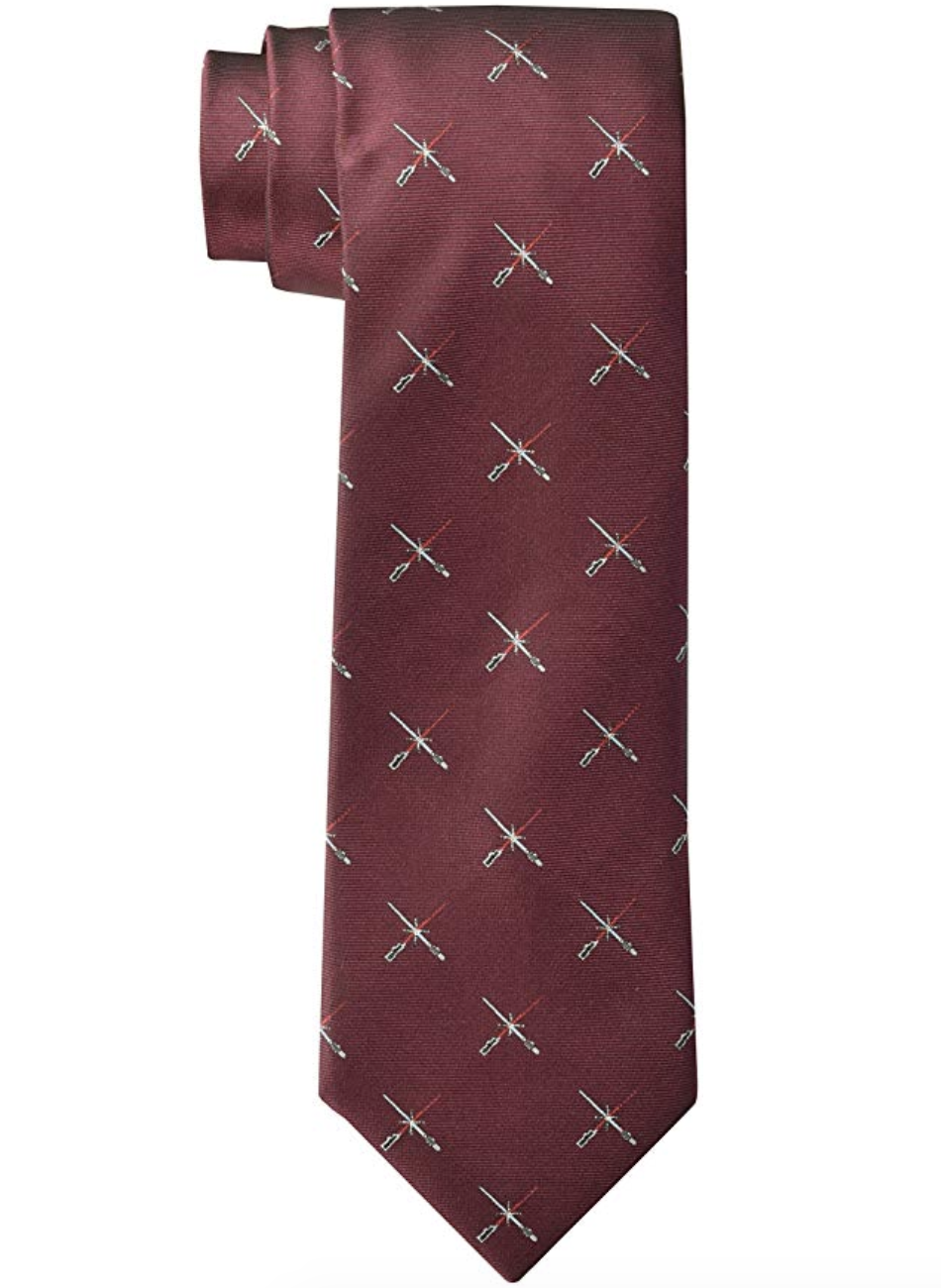 a burgundy tie with small light sabers on it
