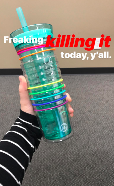 """A customer review photo of them holding the bottle with the text, """"Freaking killing it today, y'all."""""""