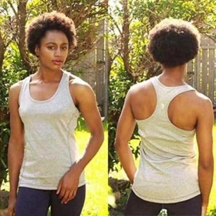 a different model wearing the tank in grey and showing the racerback
