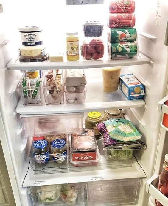 Reviewer photo of a neatly organized fridge that utilizes the storage bins
