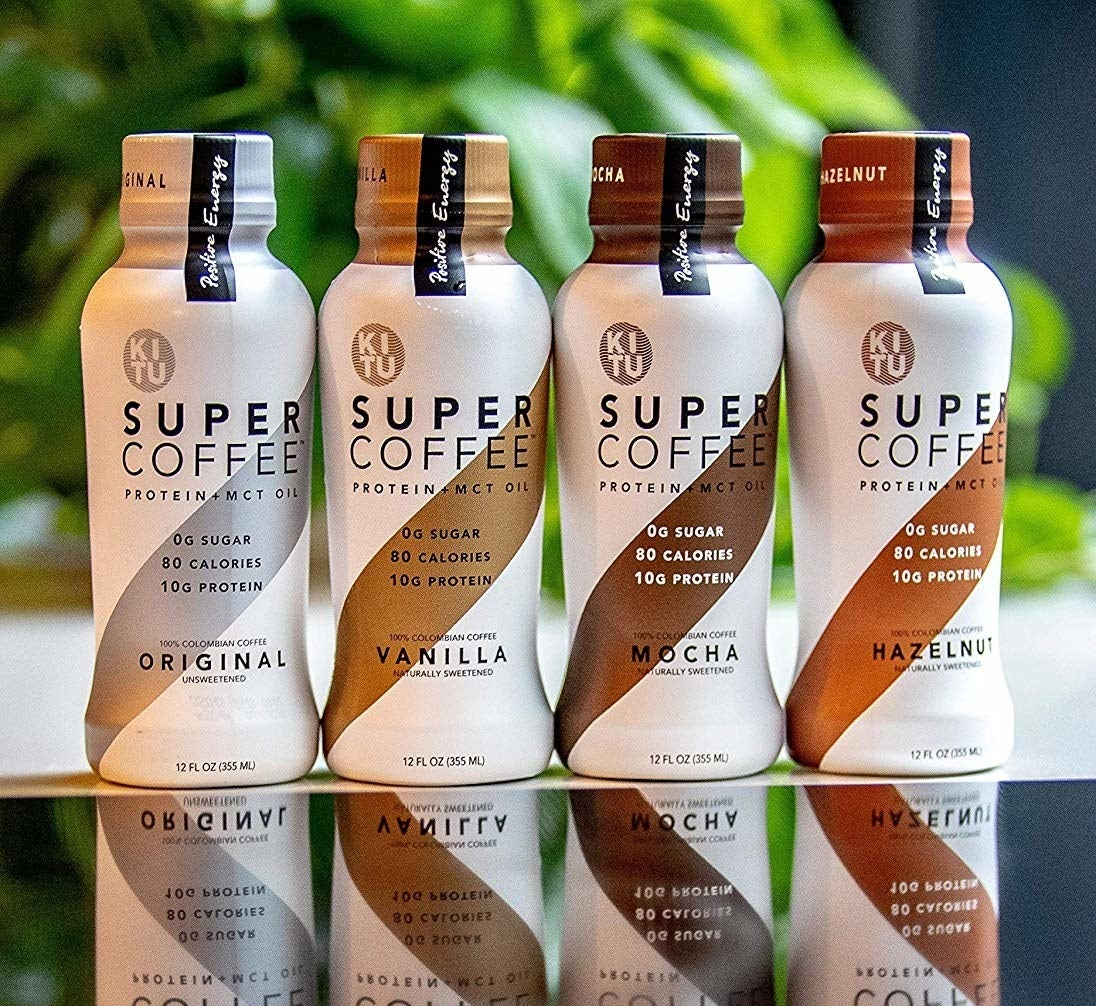 Four bottles of different flavored Kitu coffee