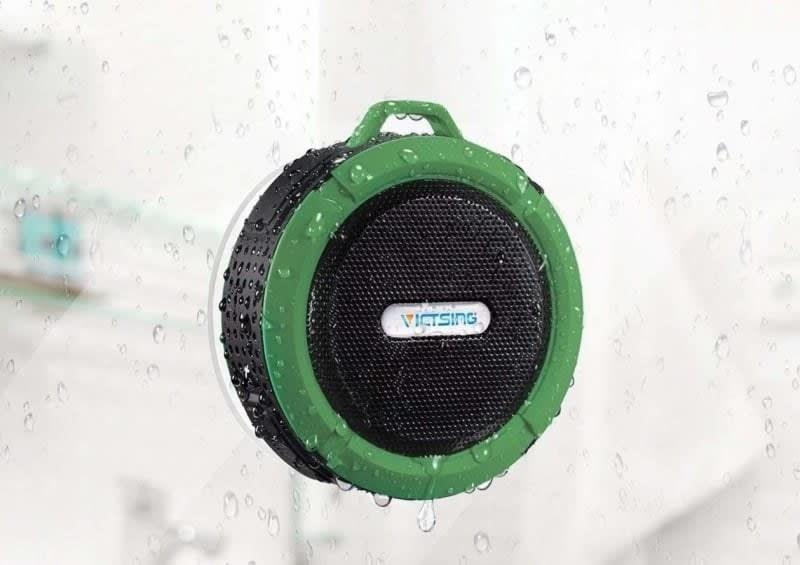 a green circular waterproof speaker