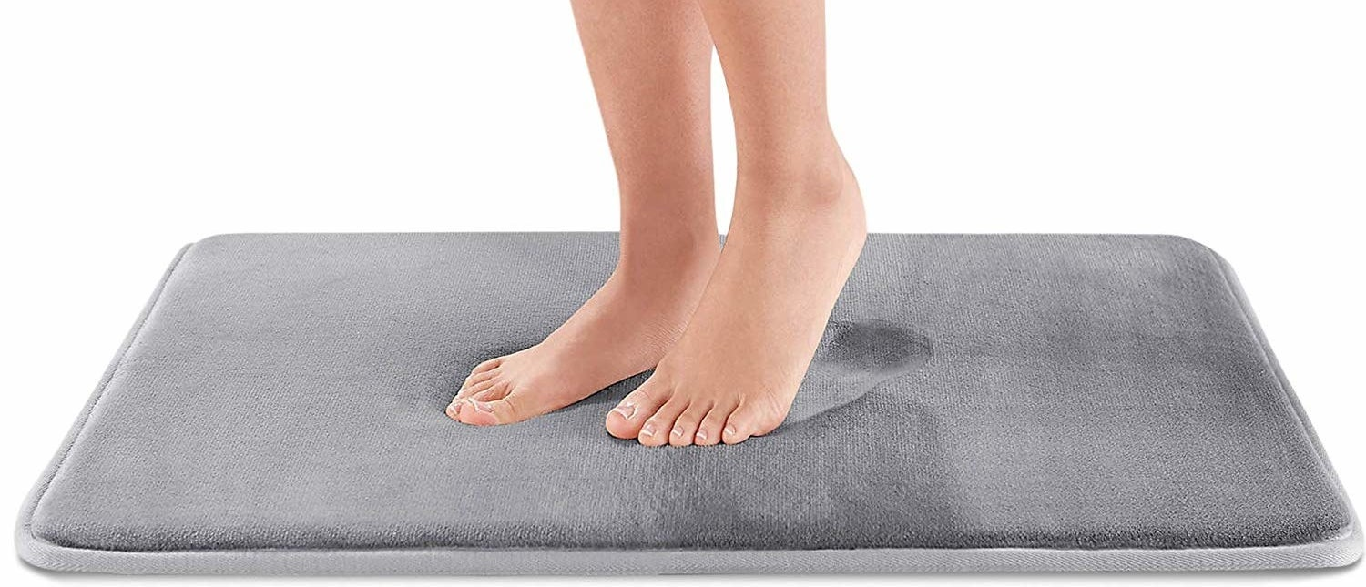 feet on grey squishy bathmat