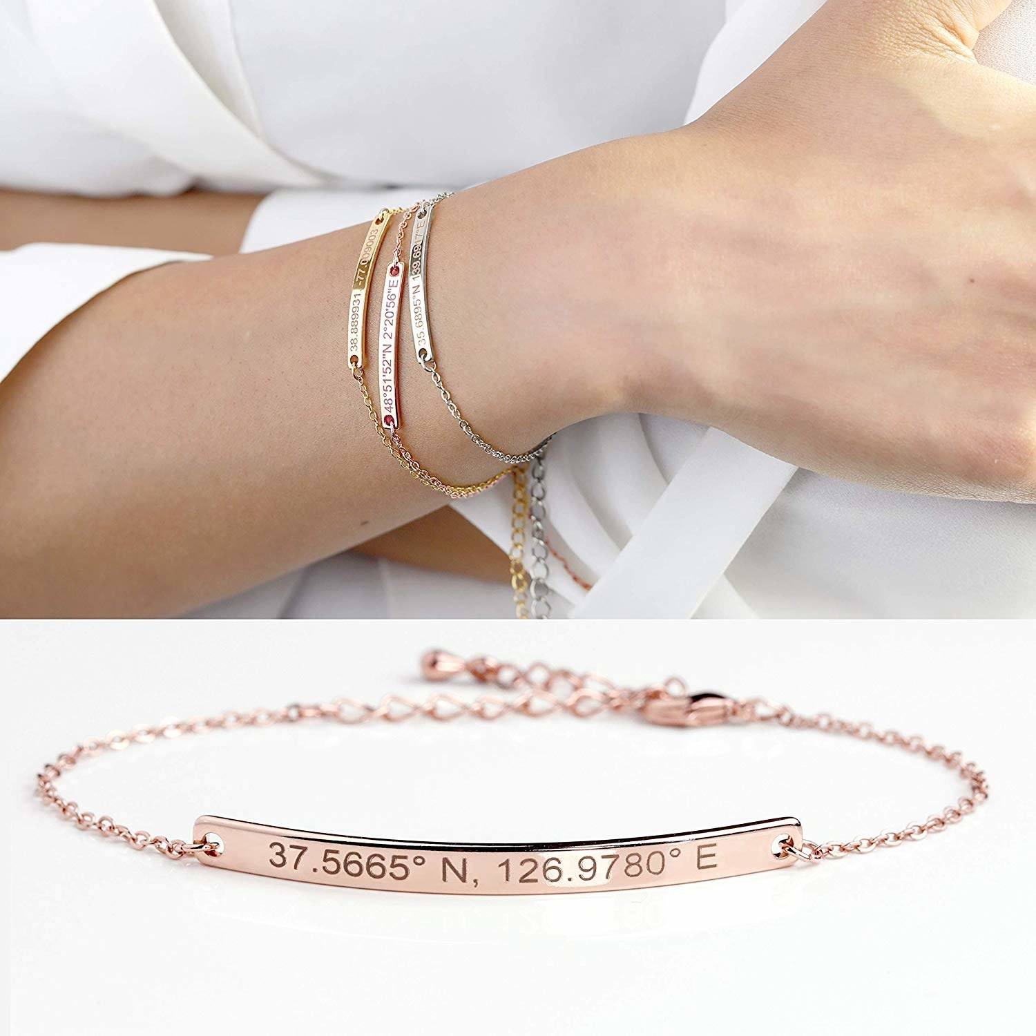 a model wearing the thin chain bracelet with a bar in the middle featuring coordinates