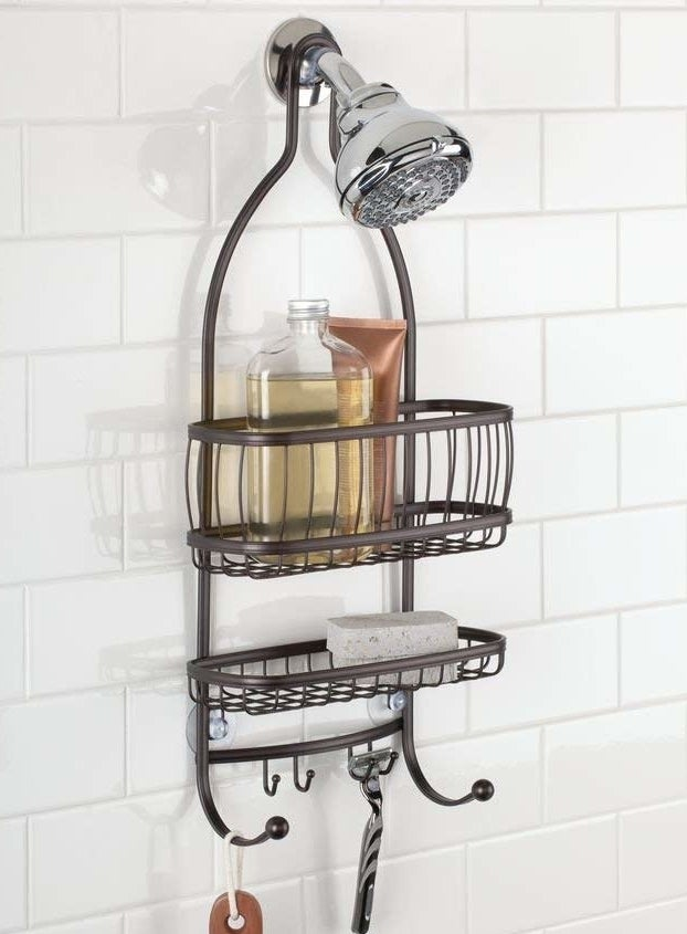 brown metallic over-shower-head rack with two racks and many hooks