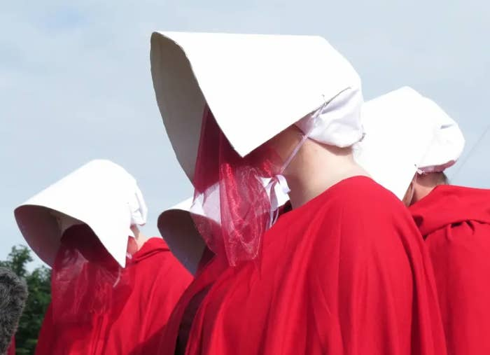 Abortion rights campaigners dressed as women from The Handmaid's Tale during a demonstration on the Isle of Man.