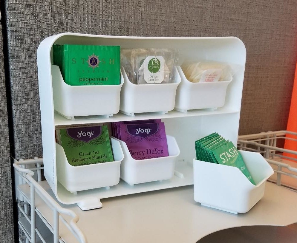 the white draw set with each compartment holding packages of tea