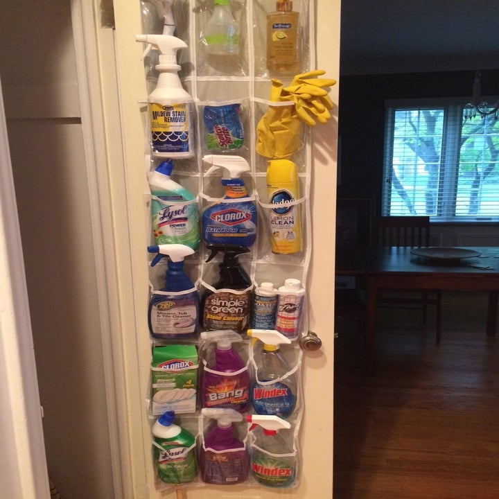a collection of cleaning supplies in the over the door organizer