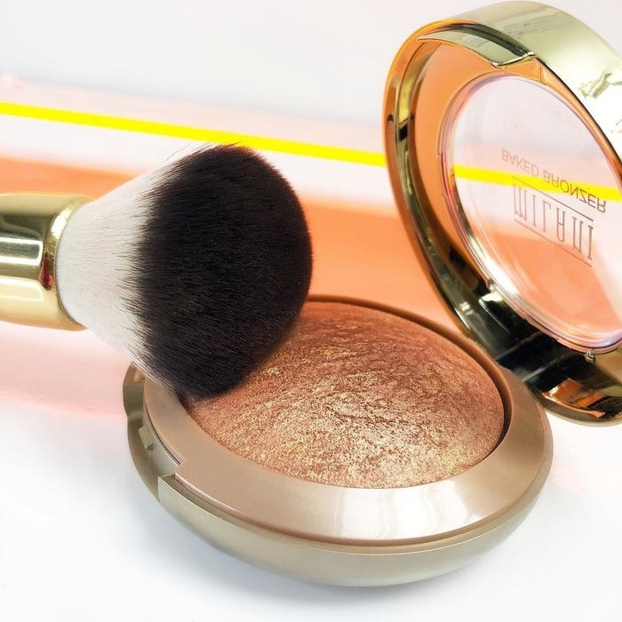 """It even comes with a lil' brush and mirror that can be stored on the bottom!Promising review: """"You know how there is always one or two products you cannot live without? This is one of mine. I won't leave home without it. I've been using it for 3-4 years now and I love it! I love the subtle shimmer and sun kissed look. The compact brings so much product you could easily go nine months without having to get a new one. I hope they never discontinue this product."""" —AixaGet it from Amazon for $7.89 or Ulta for $8.99 (available in three colors)."""