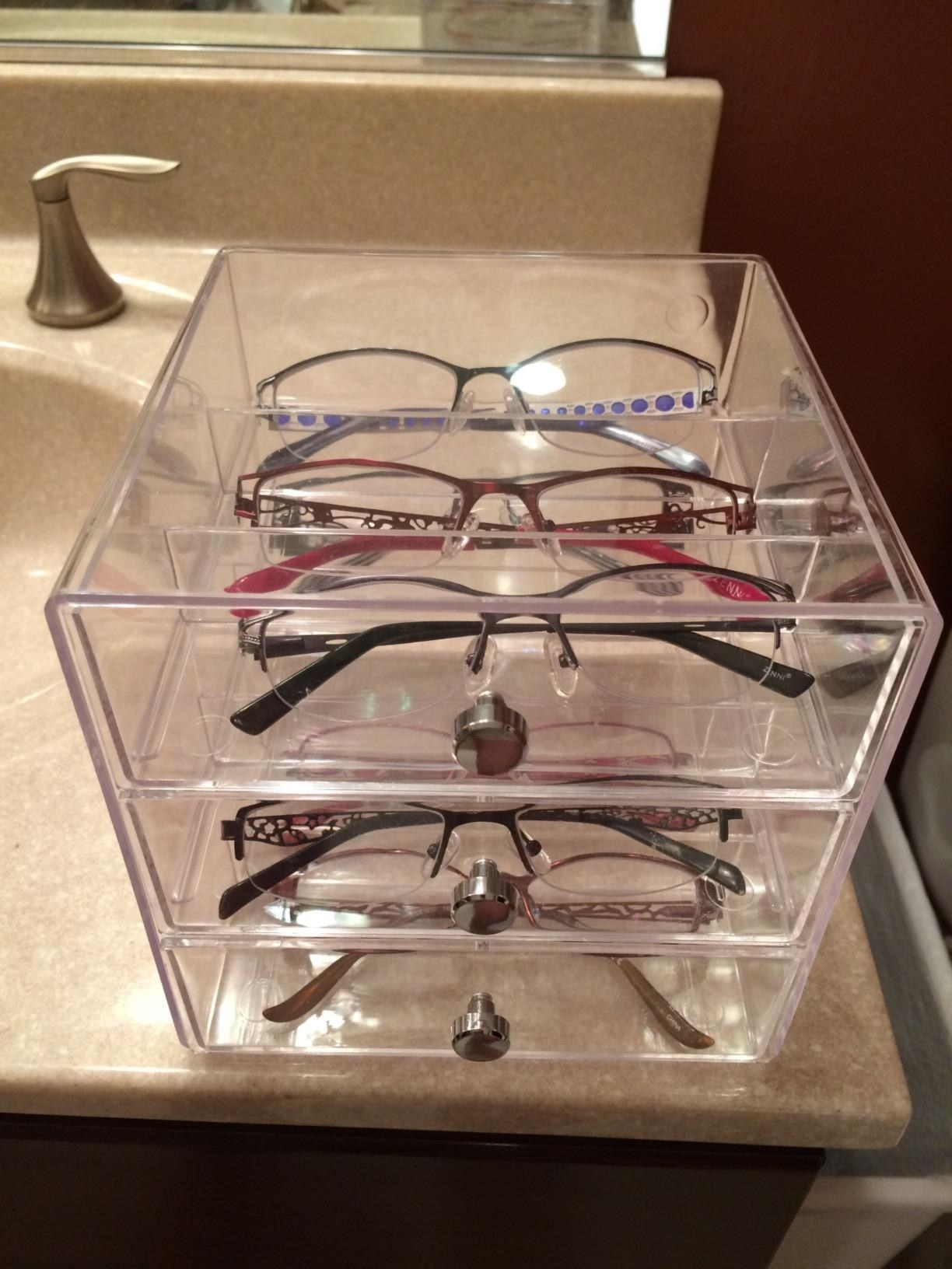 a collection of eye classes organized throughout the the shelves of the acrylic drawer