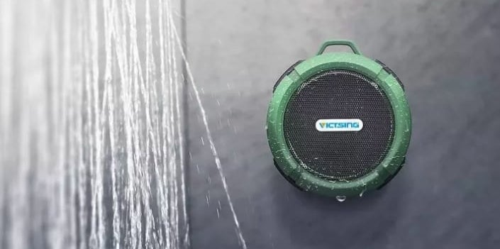 round green speaker on shower wall