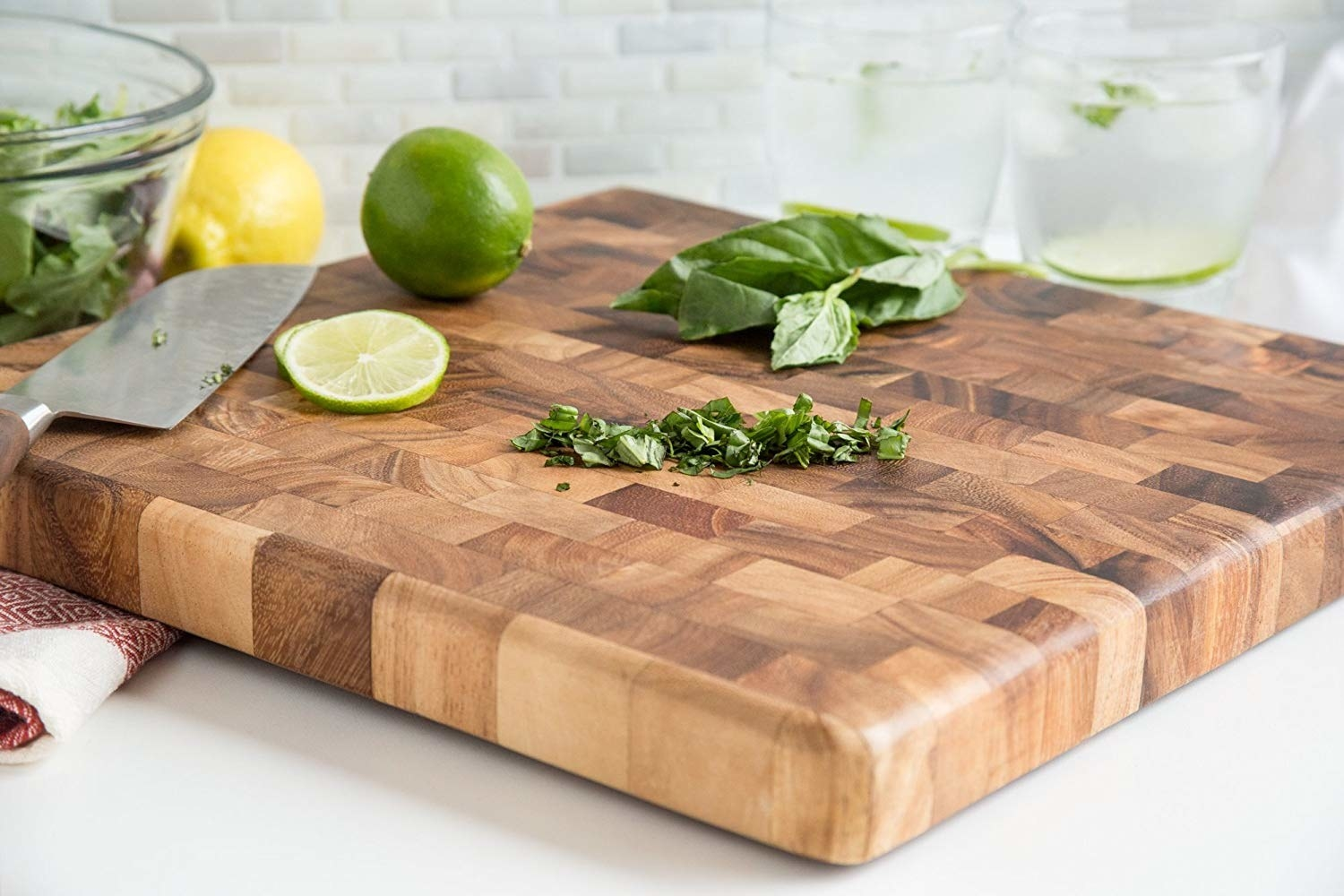 Patchwork cutting board with several shades of wood pieced together into a smooth surface
