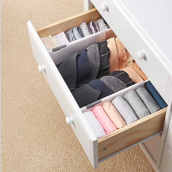 the drawer inserts holding and separating clothing in a drawer