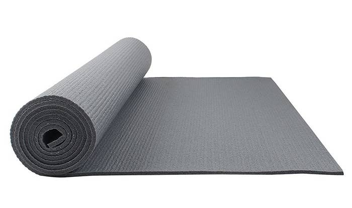 A grey FitKit yoga mat