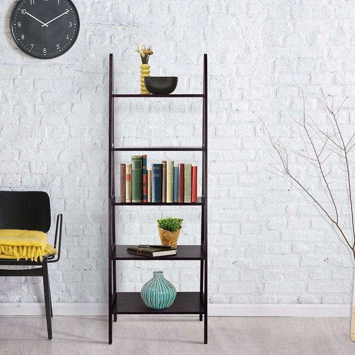 a dark brown wooden bookcase ladder