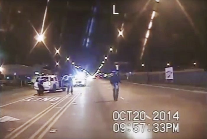 In an Oct. 20, 2014, file image taken from dash-cam video provided by the Chicago Police Department, Laquan McDonald, right, walks down the street moments before being fatally shot.