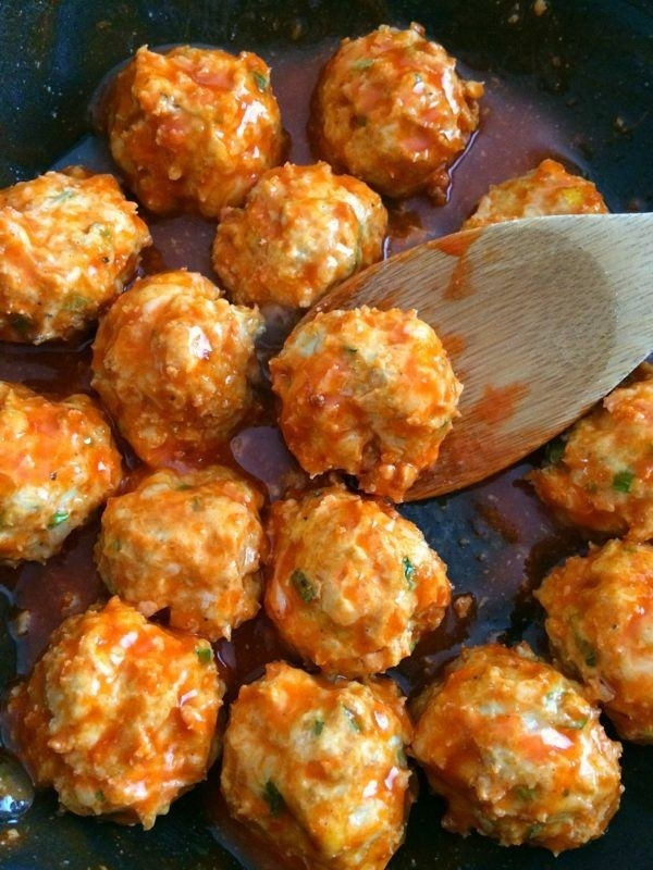 THE RECIPE: I love meatballs, so I was excited to try this recipe out. It seemed super simple: You just throw everything into a bowl, mix it up, form it into balls, bake 'em, and toss with buffalo sauce. Easy enough.The one note that I have is that I added additional almond flour (two more tablespoons to be exact) just so they were easier to roll. The mixture is super wet, and it sticks to both your hands and the mixing bowl, so I oiled my hands and used a small ice cream scoop to make the balls. I think you could get away with one tablespoon of almond flour, but this just made it a bit easier.