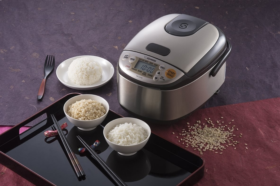 The silver rice cooker which has a digital timer and seven buttons