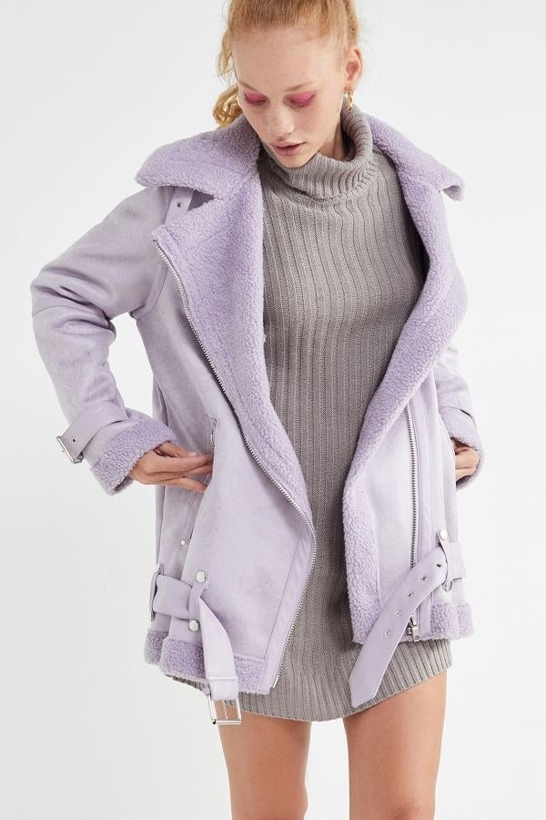 """It is meant to be boxy and oversized, so size down if you want a snugger fit!Price: $74.50 (originally $149; available in sizes XS–XL and four colors)Promising review: """"This jacket is everything and more! it gives off an amazing '70s retro look, with the cozy collar and the faux leather finish. Basically an outfit in itself! And luckily the jacket on its own is even warmer than you would imagine, but also allows room to layer a sweater underneath, if you wish. I've gotten so many compliments on this jacket and can't wait to wear it more often. P.S would highly recommend getting it in the rust color, gives off major fall vibes!"""" —Corduroy"""