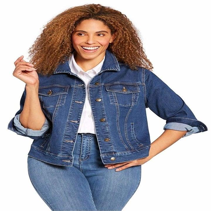 a model wearing the jacket in blue denim