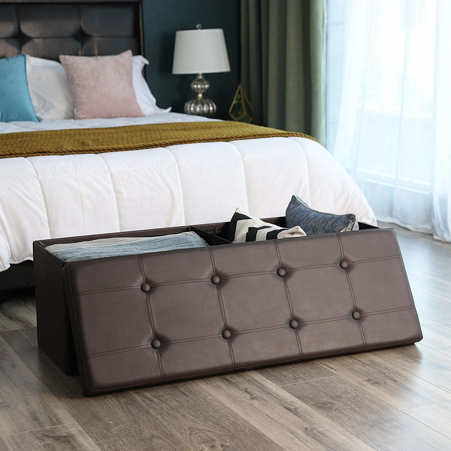 A brown rectangular storage bench with a tufted, removable top