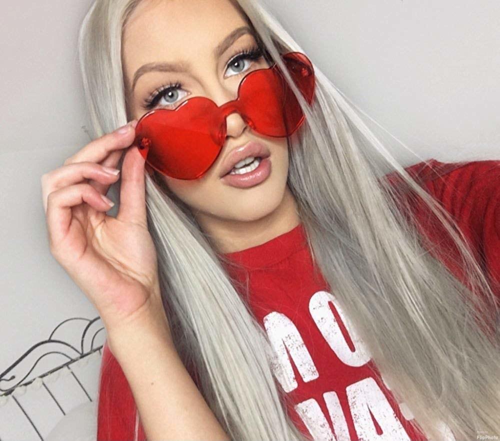 model wears heart-shaped red glasses