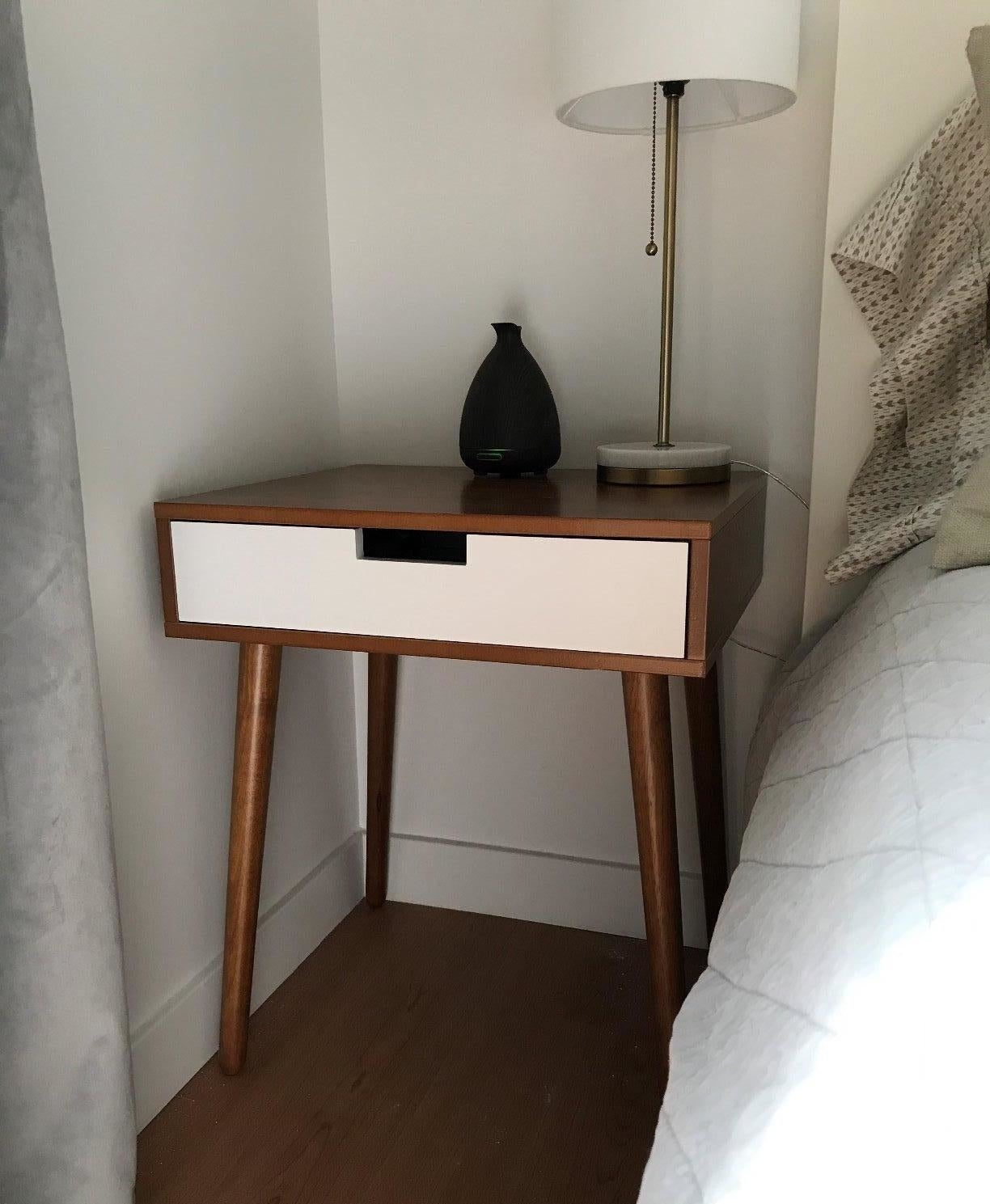 The brown and white nightstand