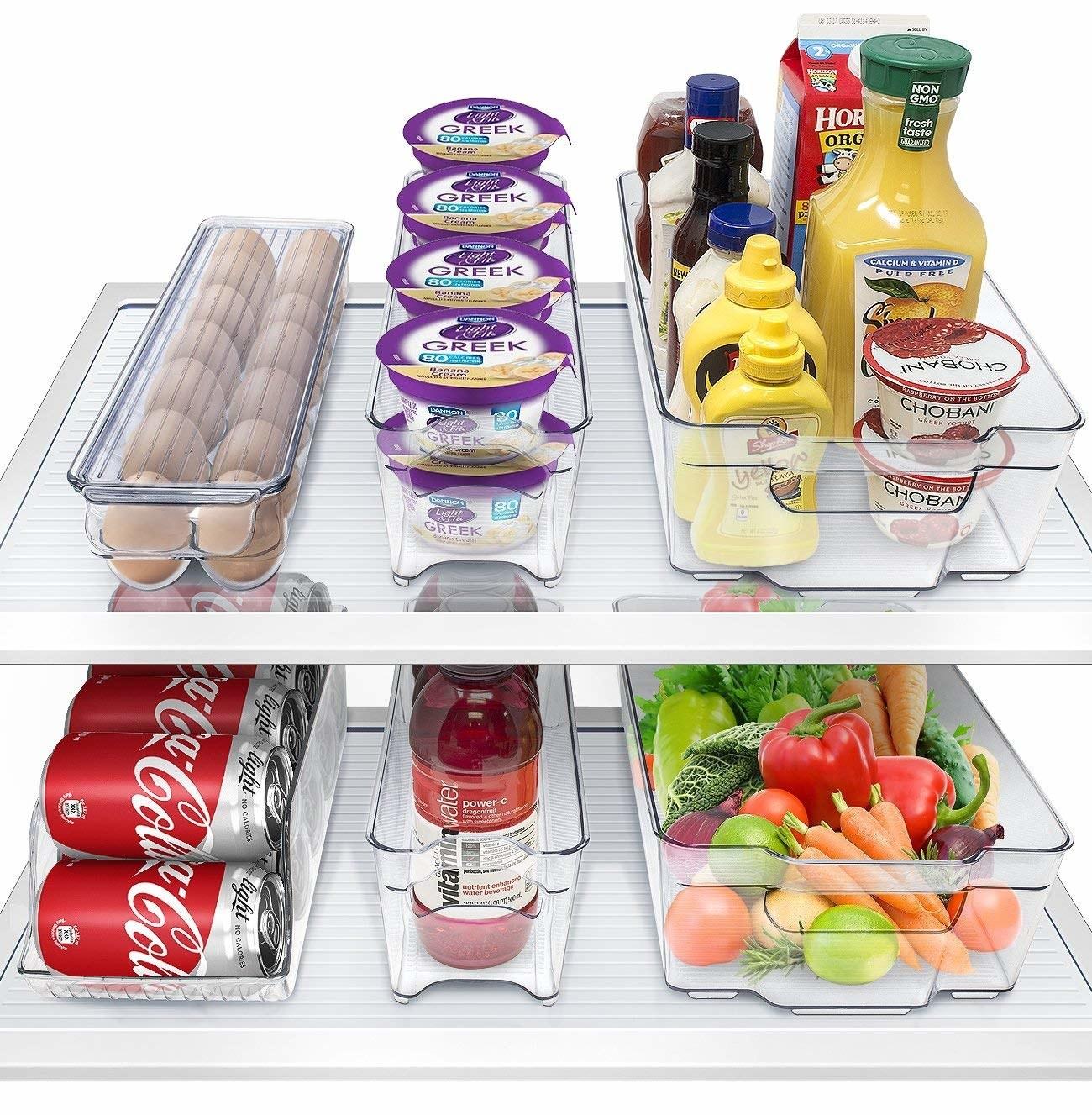 Clear bins containing food inside fridge