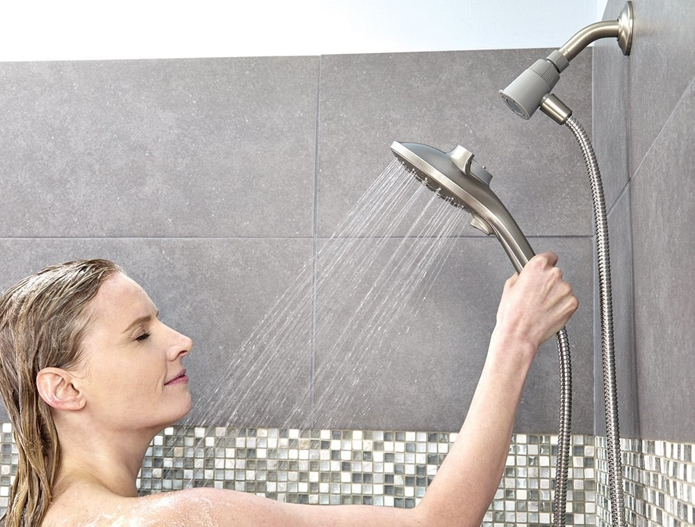model holding detachable shower head