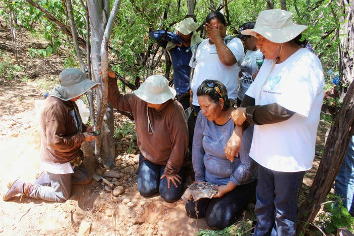 Mirna Medina Quiñónez with other members of the Rastreadoras de El Fuerte at the site where they found her son's remains, Aug. 26, 2017.
