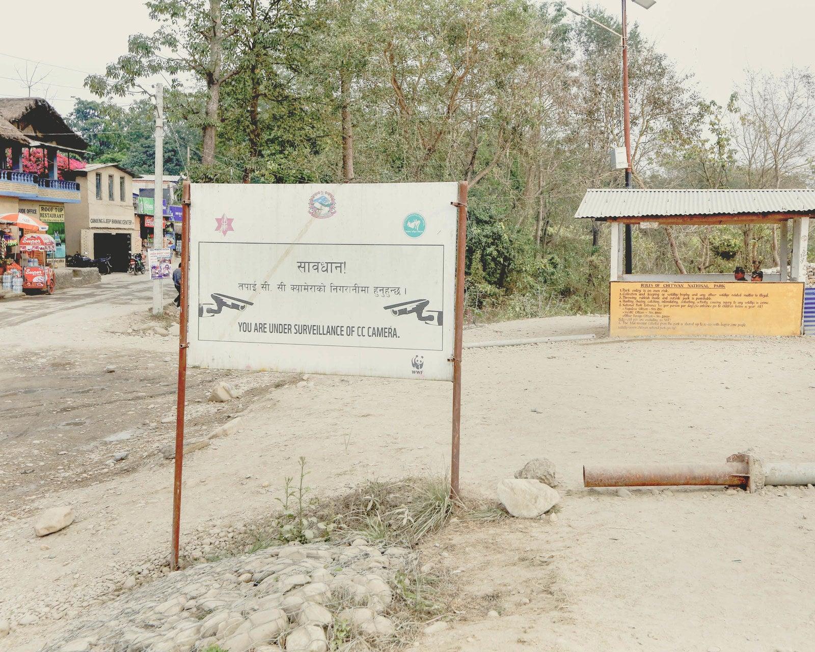 A sign near an entrance to Chitwan.