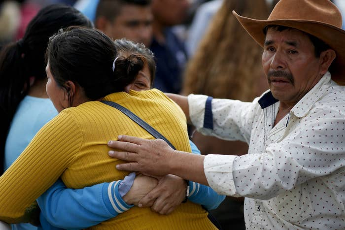 A family embraces outside a funeral service in Tula, Hidalgo state, Mexico, Saturday, after a massive fireball killed multiple people scooping up fuel from a pipeline ruptured by thieves.